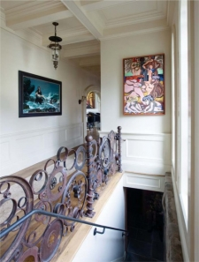 In the hall, from left to right, Progeny by Donato Giancola and The Beach by Jack Gerber; the balustrade was commissioned by the collectors.