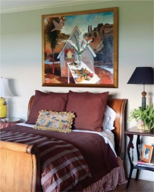 In the first floor guest room, an oil on canvas by Robert Reynolds titled La Columb D'Or.